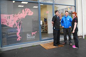 L to R: Apprentice groomer, Tom Heaton-Clarke, vet Paul Adams and salon manager and stylist, Emma Brown outside the new salon in Bowdon.