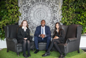 Aaron Saxton, director of training and education at UKFast (centre), with Year 9 pupils Lauren Hinton (left) and Karina Sodha (right).