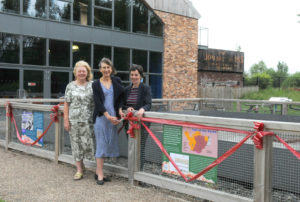 Cutting the ribbon across the new geology boards outside the Lion Salt Works Museum L-R Professor Cynthia Burek, Cheshire RIGS (Chester University Professor and first chair of Geoconservation in the world), Susan Brown, Curry Fund Secretary and Rockwatch Chair of the Geologists' Association and Kate Harland, Senior Learning and Operations Officer, Cheshire West and Chester Council.