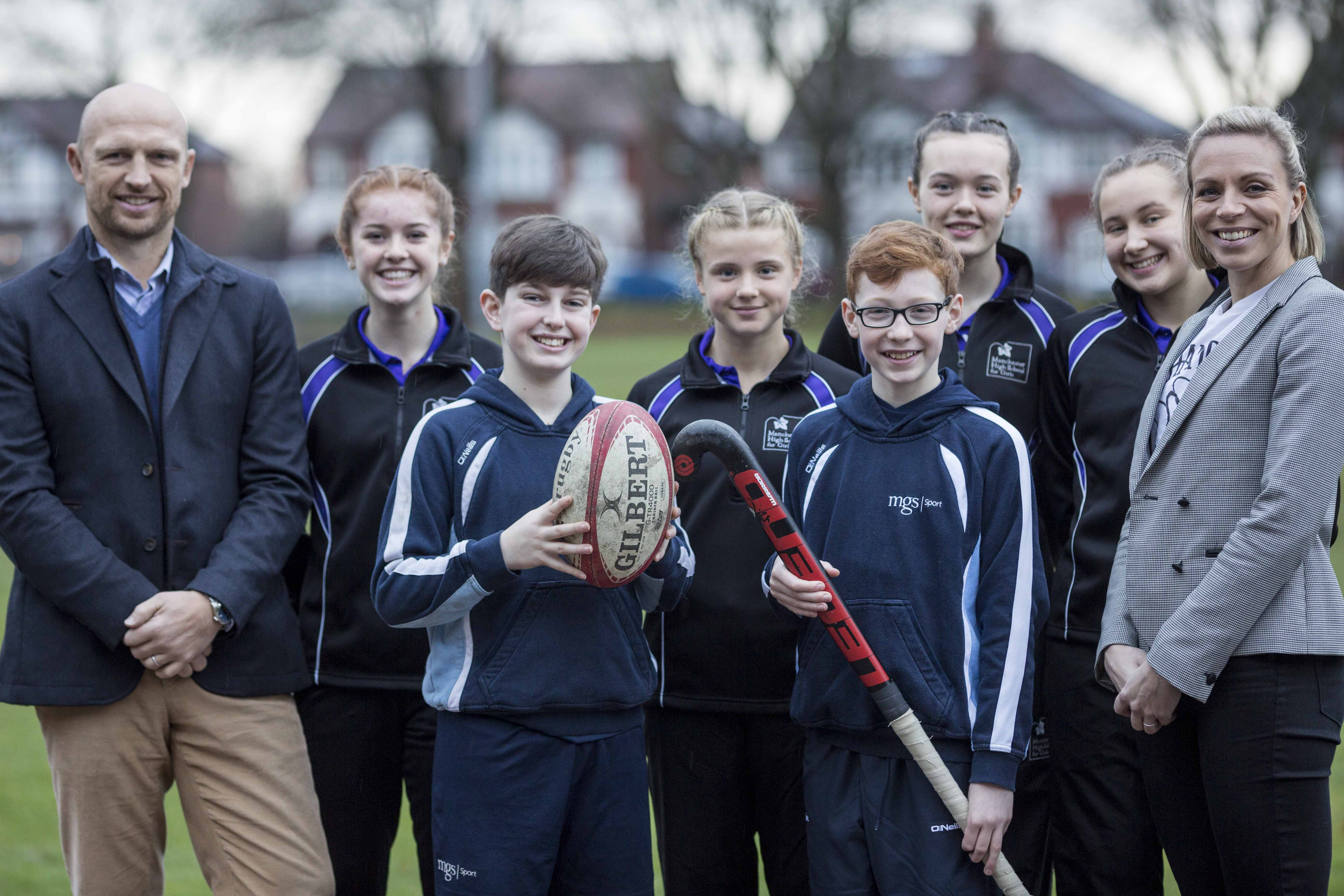Picture by Chris Bull for Manchester Grammar School.   L-R Matt Dawson , former England Rubgy Union player ,Lottie Kielty , 15 ,  Finn Perls , 12, Kizzy Ward , 13 , Henry Murray , 12 , Ella Hampson ,13 , Livi Baker ,13 and Kate Richardson-Walsh, GB Olympic gold medal hockey captain.  Students from Manchester High School for Girls (MSHG) and The Manchester Grammar School (MGS) learned that young people are among the most at-risk of contracting meningitis as two top UK sports personalities visited the schools today, Monday 15th January. Former England rugby player and BBC sports commentator, Matt Dawson, and GB Olympic gold medal hockey captain Kate Richardson-Walsh, were in Manchester to raise awareness of the devastating illness as part of pharmaceutical and healthcare company GSKÕs Tackle Meningitis Campaign.   Stefan Jarmolowicz Director of Communications The Manchester Grammar School 0161 224 7201 ext 255 s.jarmolowicz@mgs.org   www.chrisbullphotographer.com