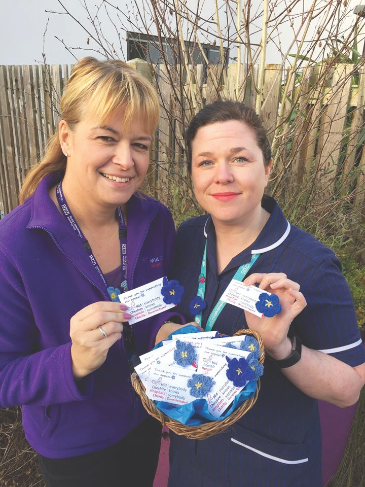 Carole Salmon, community fundraiser, Mid Cheshire Hospitals Charity and ® Sheridan Coker, Admiral Nurse at MCHT, with the Everybody Knows Somebody Dementia Appeal Forget-Me-Not pins. pins.