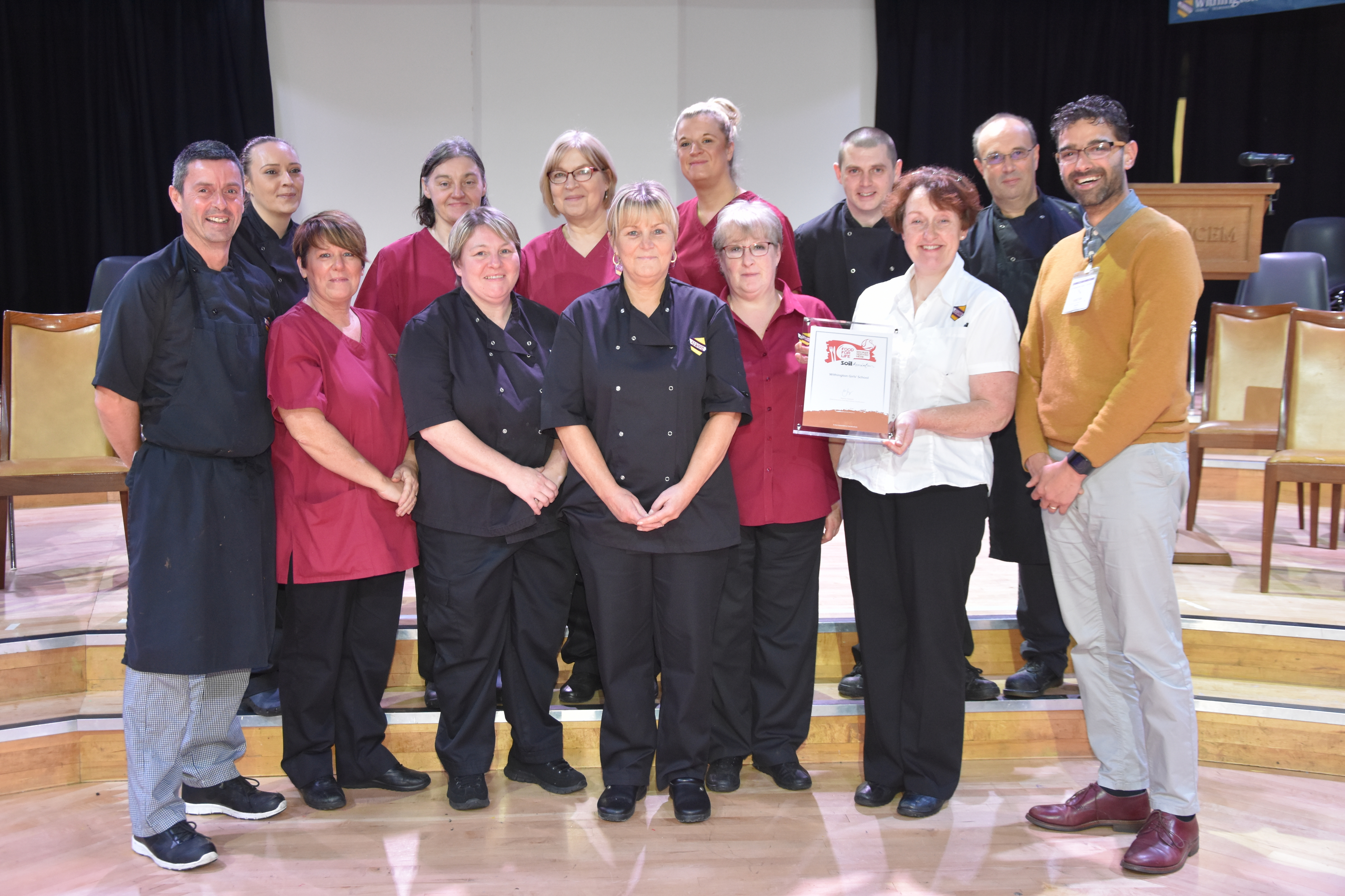 Withington Girls' School is delighted to be the first independent school in the North West to have achieved a Food for Life Served Here award. Pictured here (second from right, front row) is head of catering, Mrs Sheena Cartledge, and the WGS catering team with Soil Association development manager, David Persaud.