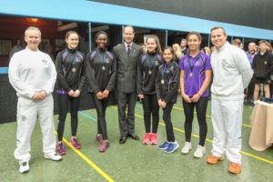 From left: Lily Holmes (14) from Alderley Edge, Nadia Anim-Somuah (15) from Fallowfield, HRH The Earl of Wessex, Parina Aggarwal (13) from Withington, Iman Sheen (14) from Didsbury, and Hannah Wall (13) from Knutsford with staff from the Manchester Tennis and Racquet club
