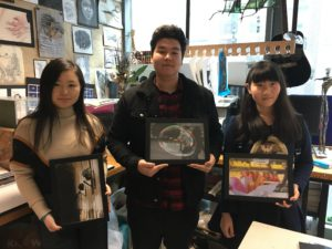 Abbey College Manchester students with their winning photography (L-R Shuyin Chen Beibarys Saparov Chen Zhu)