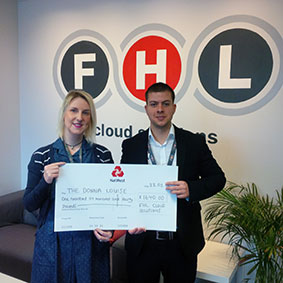 Kingsley Burn from FHL presents Katie Tams from The Donna Louise with a cheque for £1,640