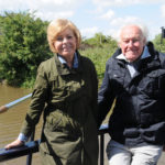Prunella Scales and Timothy West on board their narrowboat next to the Lion Salt Works Museum