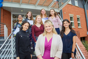 A proud Headmistress, Mrs Jeys, pictured with very happy young women this results day!