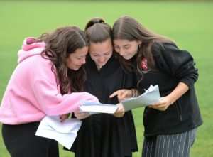 Manchester England 16 August 2018. Picture shows pupils at Withington Girls' School Manchester huddle over their exan results, left to right are Lydia Manville, Milly Jobling and Lucy Davies. Photograph by Howard Walker / Alamy News Live.