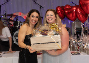 CAFT Patron Cat Kingston presents Miranda Carr with her raffle prize