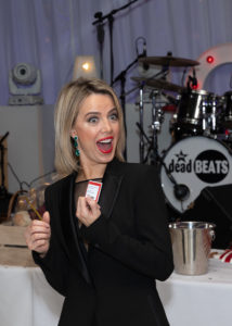 Coronation Street's Sally Carman draws the winning ticket in the Teddy Bear raffle