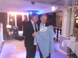 A signed football shirt was presented by former Manchester City, Manchester Utd and England legend Peter Barnes to Keith Herbert, current president.