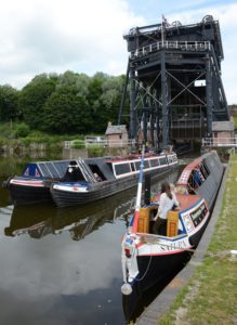 Historic boats at the bottom of the giant Anderton Boat Lift the country's first successful boat lift and still in operation today. Photo by Bob Jervis.