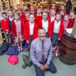 Knutsford Town Mayor, councillor Peter Coan with Egerton Primary School choir. Pic courtesy of Tatton Photography.