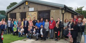 Councillor Mick Warren with staff and local residents at Bromley Farm Community Centre in Congleton.
