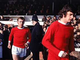 Paddy and dad running out on to the pitch for another United match.