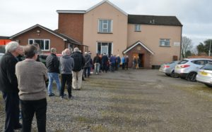 Queuing out of the door to be tested