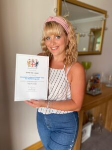 Emilie with her certificate.
