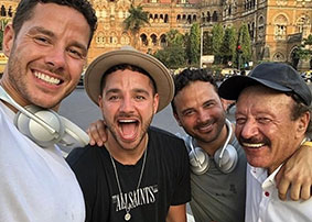Brothers Scott, Adam and Ryan Thomas with their dad, Dougie James