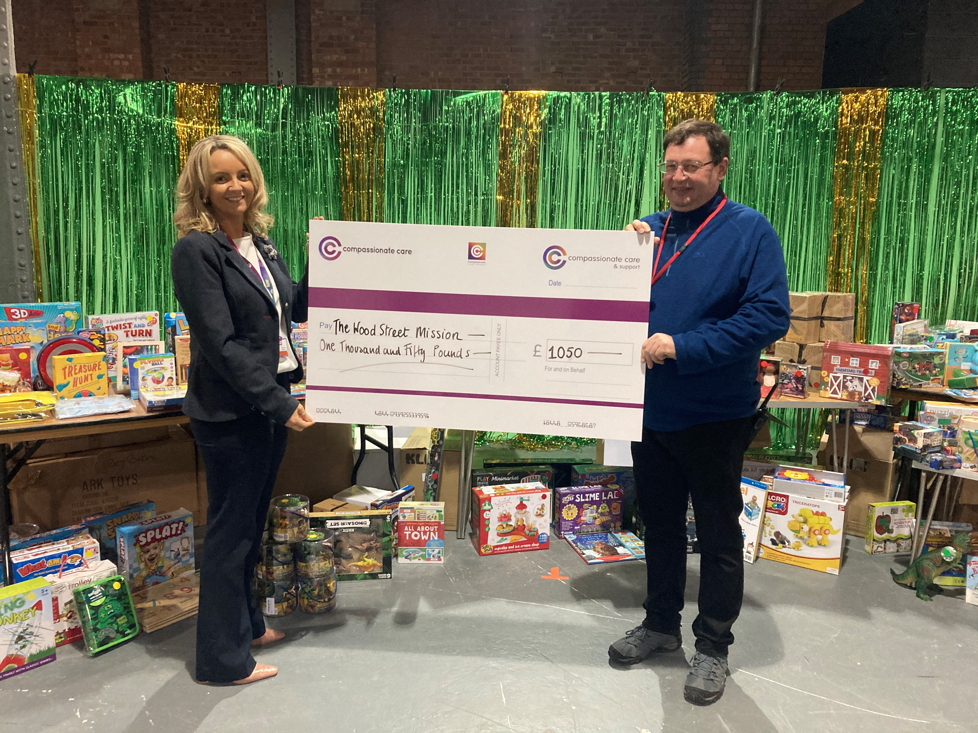 Amanda presents the cheque to Wood Street Mission
